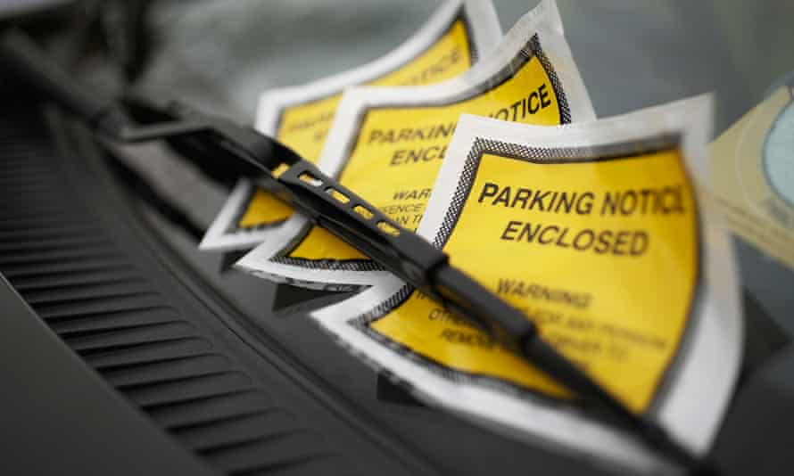 Parking tickets on a vehicle's windscreen