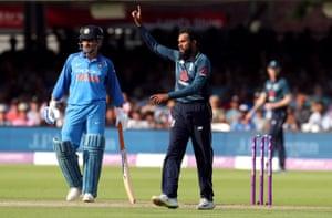 England's Adil Rashid celebrates after taking the wicket of India's Umesh Yadav.