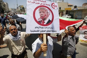 """Palestinian demonstrators protested the visit, holding signs reading """"US policy is shameful to humanity"""" at the Qalandia checkpoint in the occupied West Bank"""