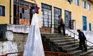 An elderly couple enter a polling station during the parliamentary election in Gabrovdol, Bulgaria.