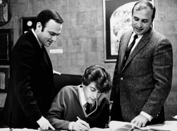 James signing a contract with Morris Levy (right), circa 1970.