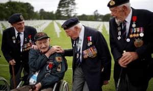 WWII D-Day veterans, including Richard Llewellyn and Mervyn Kersh from Britain and Norman Duncan from the U.S., attend a ceremony at Normandy American Cemetery and Memorial situated above Omaha Beach on the 75th anniversary of D-Day at Colleville-sur-Mer, France