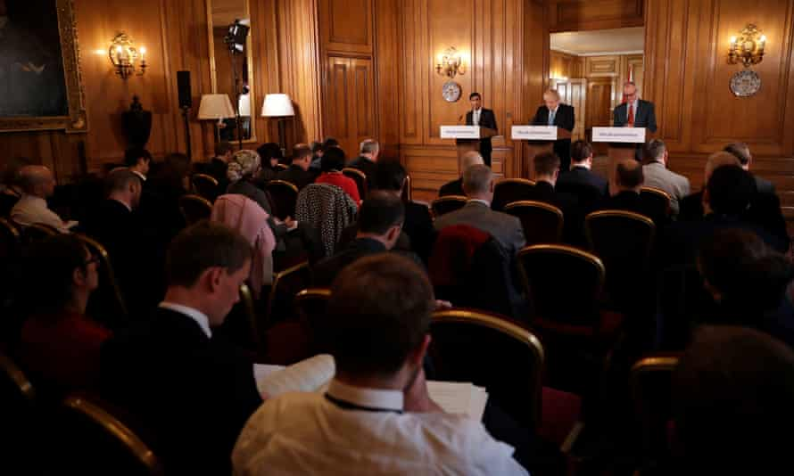 Rishi Sunak, Boris Johnson and Vallance give a press conference in Downing Street on 17 March 2020.
