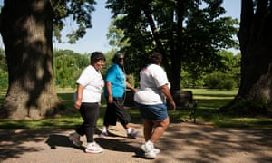 Members of a Catholic-backed walking club exercise in Tower Grove Park, St Louis.