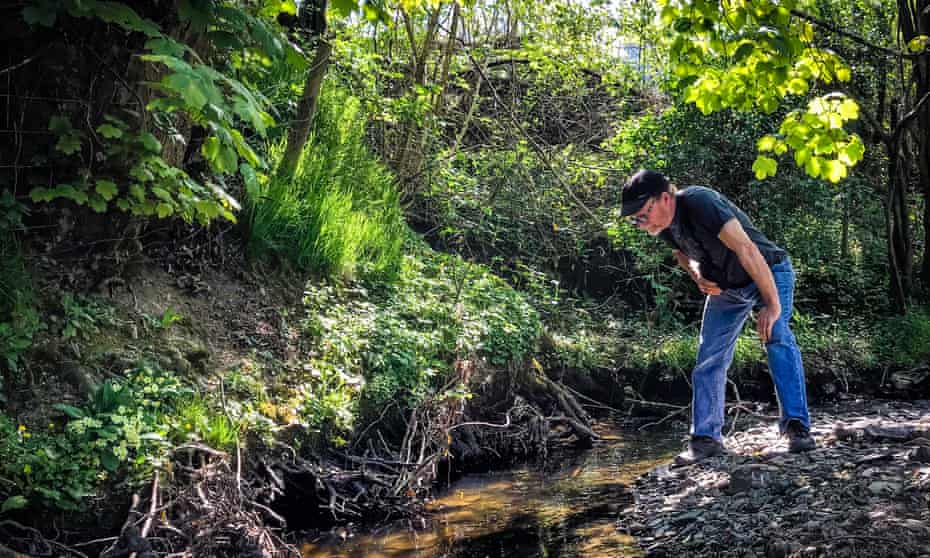 Kevin Rushby looking at a stream.