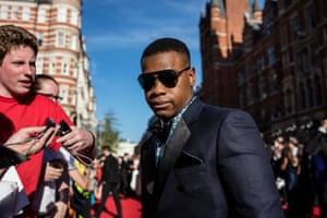 John Boyega arrives to present the award for best director