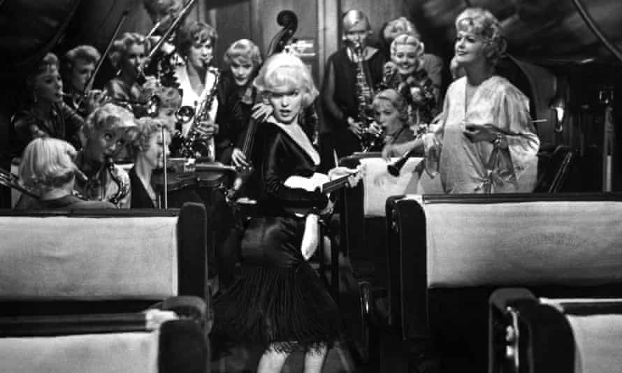 Marilyn Monroe as Sugar Kane, singer and ukulele player for the female band in Some Like It Hot.