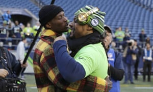Chad Johnson (left) greets Seattle running back Marshawn Lynch before a game in December.