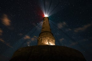 Lighthouse lit up at night