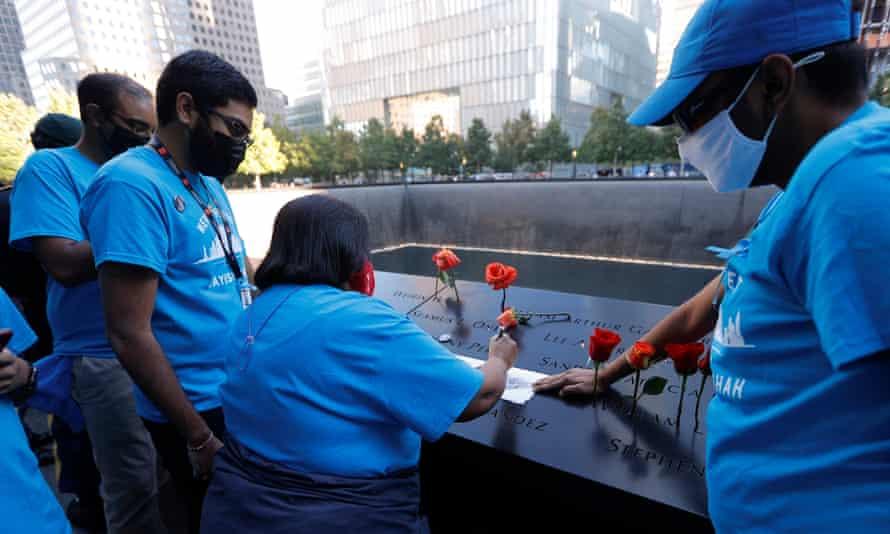 Family members of Jayesh Shah make a rubbing of his name at the 9/11 Memorial.