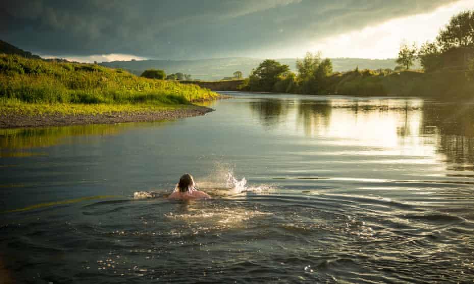 Daniel Start wild swimming in a River.
