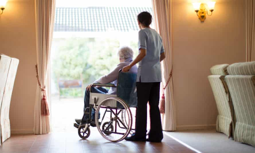 A resident and staff member at a nursing home