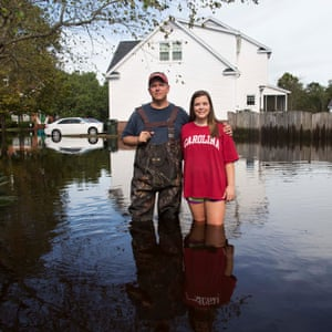 David and Elaine Samios in Summerville South Carolina USA outside flooded home