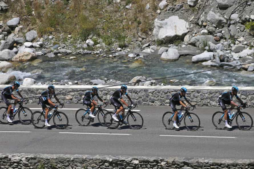Chris Froome sits third wheel as his Team Sky team-mates guide him up the Tourmalet.