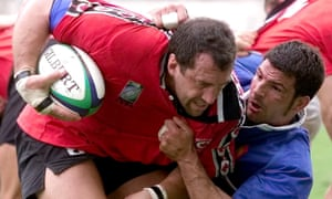 Al Charron is tackled by French flanker Marc Lievremont in Beziers, at Rugby World Cup 1999.