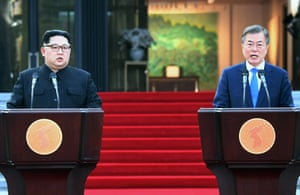 President Moon Jae-In and North Korean leader Kim Jong-Un announce an agreement after signing a document at the Peace House