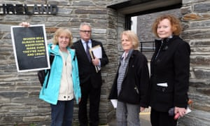 Colette Devlin, Diana King and Kitty O'Kane, with solicitor Des Doherty going into Strand Road police station in Derry.