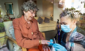 Helen Morrison gets a manicure from Wendy Banza, a care worker, at David Walker Gardens Care Home