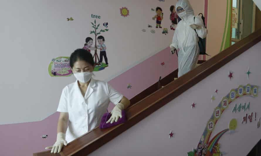 Staff of the Pyongyang Primary School No. 4 clean stairwells in Pyongyang, North Korea,