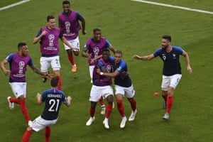 France starters and substitutes celebrate with Kylian Mbappé after his goal against Argentina.