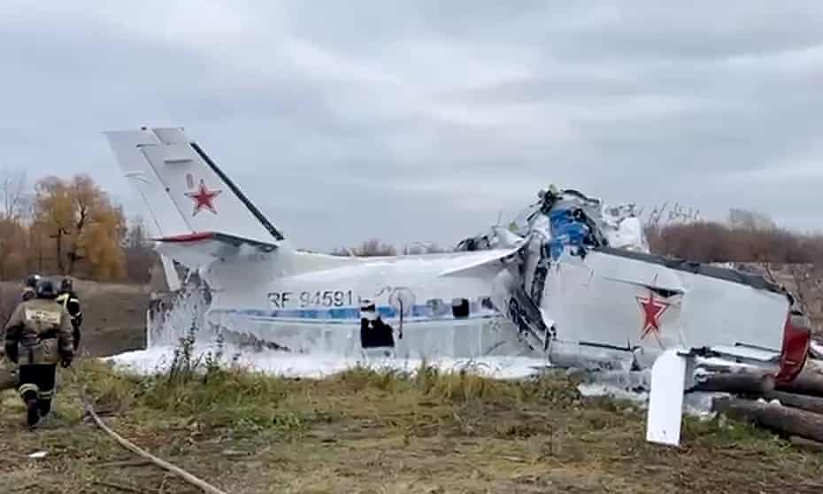 Rescue workers inspect the L-410 light aircraft after it crashed in Tatarstan.
