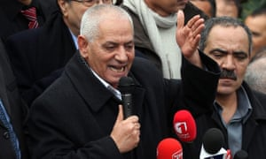 A file picture of Houcine Abassi, secretary general of the Tunisian General Labor Union, speaking to supporters.