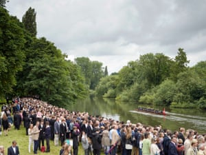 Annual Eton College Procession of Boats, River Thames, Windsor, Berkshire, 17 June 2016Parents of students at Eton College stand on Fellows' Eyot overlooking the River Thames as the Fourth of June procession passes by. Originally a celebratory commemoration of the king's birthday, nowadays it is unlikely to fall on that exact date, and represents a symbolic gesture marked by a day of speeches, cricket, and the Procession of Boats in which the best oarsmen from the school row past an assembled crowd on the riverbank.