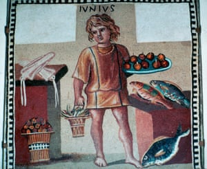 Death in the air ... Roman mosaic from Pompeii, of a boy slave in a kitchen with fruit and fish.