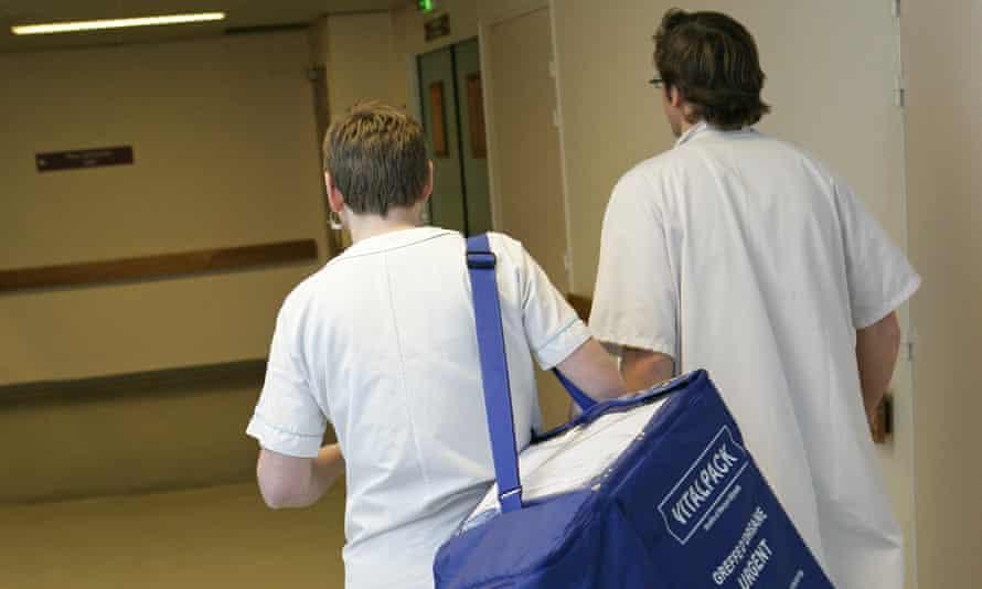 Medics bring a transplant organ to a surgeon at a hospital in Rouen, France.