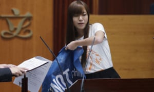 """Yau Wai-ching displays a banner with words reading """"Hong Kong is not China"""" as she takes oath in the legislature council."""