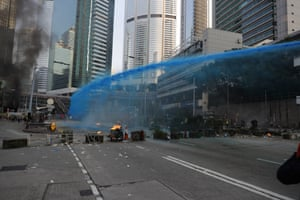 Police use blue dyed water to disperse anti-government protesters.