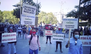 Owners of restaurants and cafes affected by coronavirus gather to stage a protest in Madrid