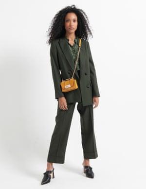 model wears blazer, £169, and trousers, £79.95, massimodutti.com. Shirt, £29.99, mango.com. Heels, £229, joie.com. Bag, £10, asos.com