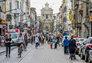 Pedestrians and cylcists enjoy the freedom of the roads of Brussels