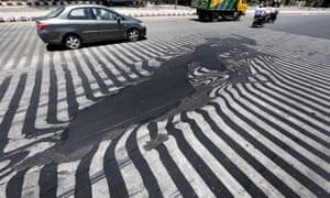 Melting asphalt caused road markings to distort in New Delhi, during a 2015 heatwave.