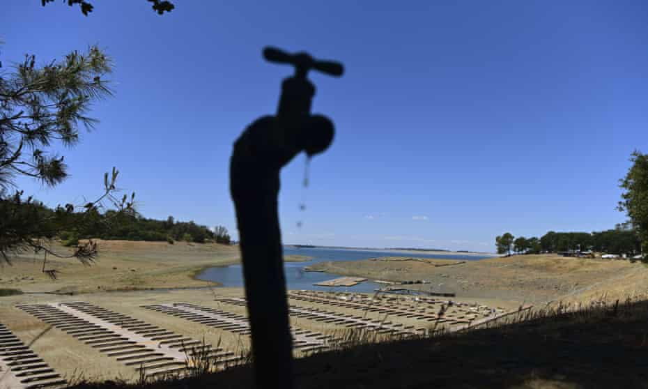 Water drips from a faucet near boat docks sitting on dry land at the Browns Ravine Cove area of drought-stricken Folsom Lake, California