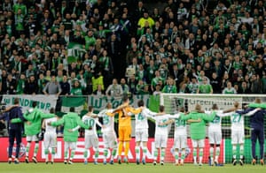 The Wolfsburg players celebrate a famous victory with their supporters.
