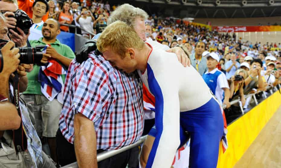 'It seems my dad was being harsh but he wasn't' … Hoy celebrates with his father after winning another gold in Beijing.