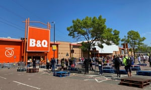 People queuing outside a B&Q DIY store, Watford, Britain,in April.