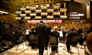 The London Philharmonic Orchestra on the Royal Festival Hall stage.
