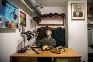 A dummy of a policeman sits at a table as part of an exhibition at the cold war-era nuclear shelter inside the Jalta hotel in Prague, Czech Republic
