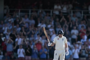 Joe Root raises his bat as he reaches 50.