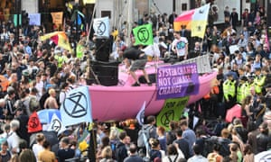 Extinction Rebellion protesters, with pink boat, in London