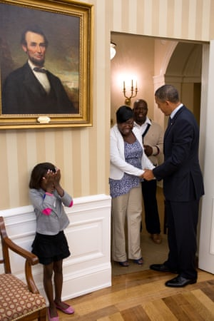 8 August: 'Overcome with emotion, eight-year old Make-A-Wish child Janiya Penny reacts just after meeting the president as he welcomes her family to the Oval Office'