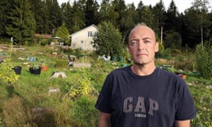Phil Daoust poses in his garden in the forest of Vosges in eastern France.