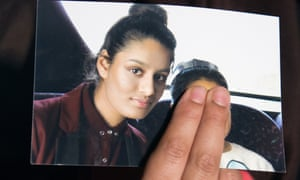 Renu Begum holds a photograph of her sister Shamima Begum