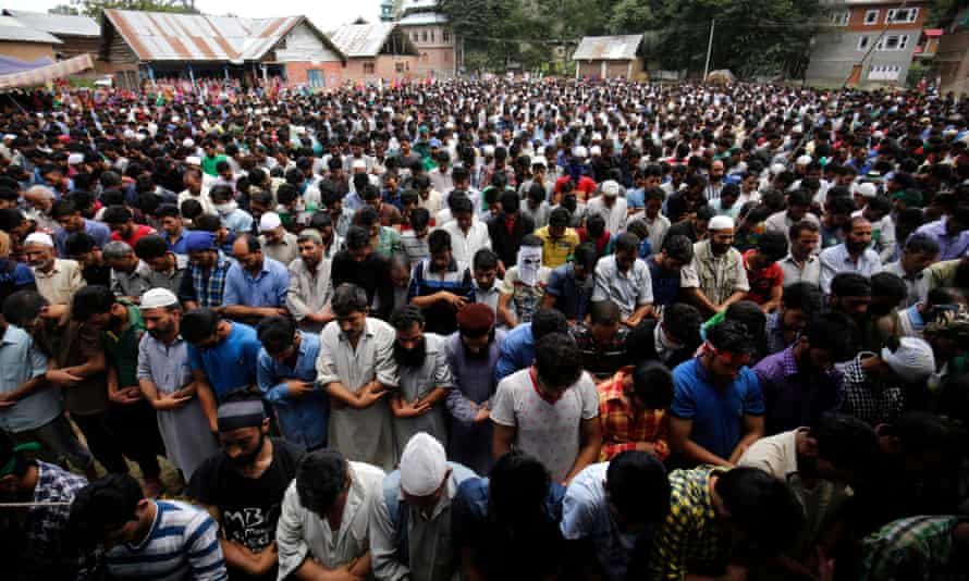 Hundreds of people attend the funeral of four civilians killed in Aaripanthan village on Tuesday.
