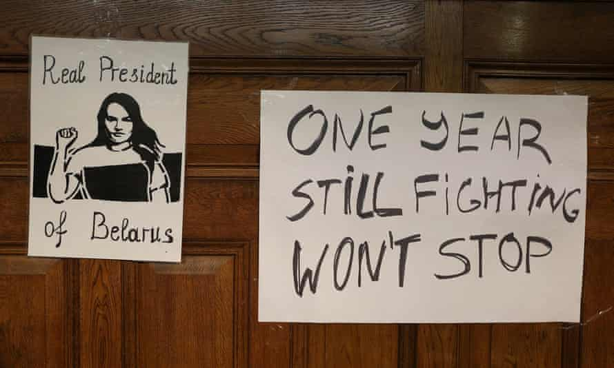 Posters are seen on a wall at an event where Tsikhanouskaya was speaking in London
