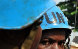 A UN peacekeeper patrols in a street in Abidjan, Ivory Coast.