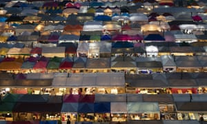 Tents of food stalls and other vendors are illuminated at Rot Fai Market in Bangkok, Thailand as daily life resumes in the capital.